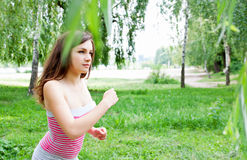 Morning jog in the park. Woman on a morning jog in the park Royalty Free Stock Photo