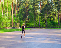 Morning jog in wood. Royalty Free Stock Photo