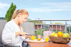 Morning juice on terrace. Woman making morning juice on terrace royalty free stock photos