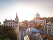 Morning in Kiev Kiyv Ukraine. Andrew`s Descent. Castle of Richard the Lionheart and St.Andrew`s Church. Soft sunrise light Royalty Free Stock Photo