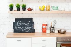 "Morning kitchen with plate ""Good morning!"" Stock Photo"