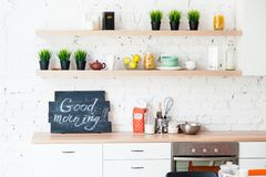 "Morning kitchen with plate ""Good morning!"" Royalty Free Stock Images"