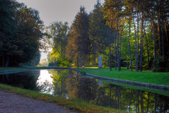 Morning Lake. Surrounded by autumn forest Stock Photo