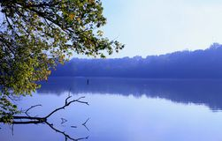 Morning Lake. Placid lake in early morning mist with reflections stock image
