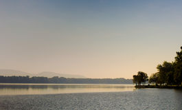 Morning on the lake. Misty morning on a lakeside Royalty Free Stock Photography