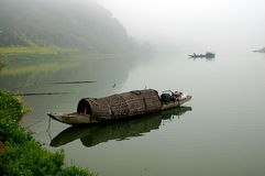 Morning in the Lake. Picture shows a traditional ferry boat in the lake Stock Image