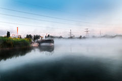 Morning on the lake. As the water spreads low fog. Royalty Free Stock Photo