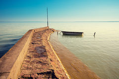 Morning on the lake. Boat near pier royalty free stock photography