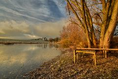 Morning on the lake. Frosty morning in late November at the frozen lake Stock Images