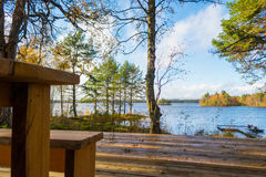 Morning at the lake. Just imagine ... you wake up in the morning, go out on the porch, and there is an azure sky reflected in the gentle waves of the lake. Is Stock Images
