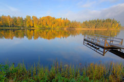 Morning lake reflections Stock Images