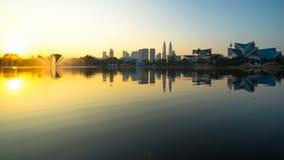 Morning at lake Titiwangsa, Malaysia. KUALA LUMPUR, MALAYSIA - FEBRUARY 20, 2015: Sunrise view of Kuala Lumpur at Lake Titiwangsa, Malaysia.The lake is located Royalty Free Stock Photo