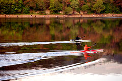 Two kayaks. Morning at the lake with two man with kayaks Royalty Free Stock Image