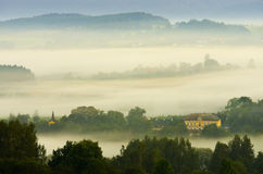 Morning landscape. Shrouded in fog Stock Photos
