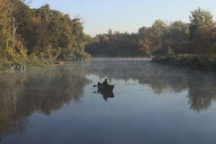 Morning landscape with fishermen on the river.  stock images