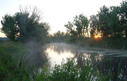 Morning landscape with fog on the river Stock Photo