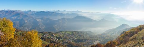 Morning landscape on hills and mountains with humidity in the air and pollution. Panorama from Linzone Mountain Royalty Free Stock Image