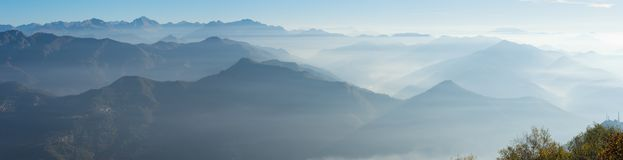 Morning landscape on hills and mountains with humidity in the air and pollution. Panorama from Linzone Mountain Royalty Free Stock Images
