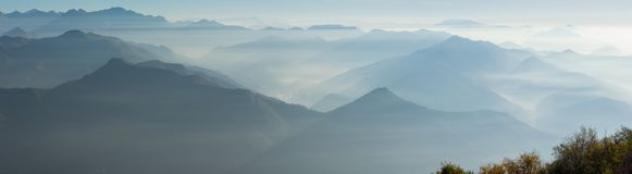 Morning landscape on hills and mountains with humidity in the air and pollution. Panorama from Linzone Mountain Stock Photo