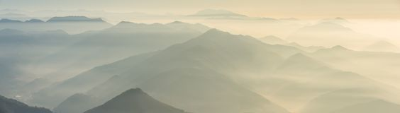 Morning landscape on hills and mountains with humidity in the air and pollution. Panorama from Linzone Mountain Stock Image