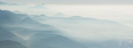 Morning landscape on hills and mountains with humidity in the air and pollution. Panorama from Linzone Mountain Royalty Free Stock Photos