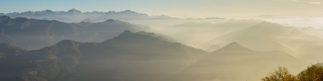 Morning landscape on hills and mountains with humidity in the air and pollution. Panorama from Linzone Mountain Royalty Free Stock Photography