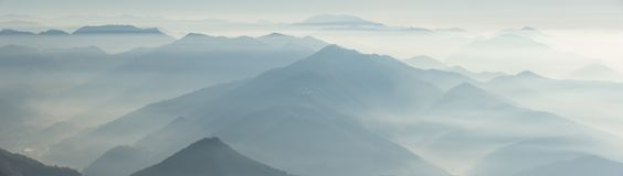 Morning landscape on hills and mountains with humidity in the air and pollution. Panorama from Linzone Mountain Stock Photography
