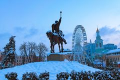 Morning landscape of Kontraktova SquareSquare of Contracts. View of the Ferris wheel, the Monument to Petro Sahaidachny. And historical buildings. District royalty free stock photos