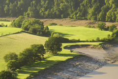 Morning landscape in the lower River Wye Valley. Morning landscape with fields and shadows,  River Wye at the Lancaut Peninsula, Gloucestershire, England, United Stock Photography