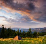 Sunrise in the mountains with a tent Royalty Free Stock Photography