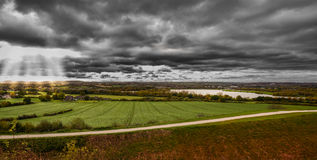 Morning landscape panoramic view. Morning landscape panoramic view with stormy black&white  cloudy sky Stock Photography