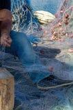 Morning landscape photo made in Gallipoli pier, fishermen reparing his fishermen net after fishing, Apulia, Italy stock image