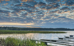 Morning landscape with a small fishing piers at a big lake Stock Photos