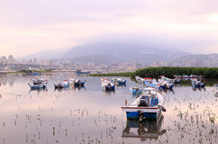 Morning landscape with stranded boats on Tamsui river Stock Photo