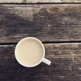 Morning latte. Morning coffee cup on nice wooden Royalty Free Stock Photo