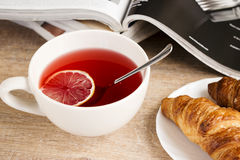 Morning lemon tea with croissant Stock Photography