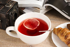 Morning lemon tea with croissant Stock Image