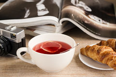 Morning lemon tea with croissant Stock Images