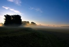 Morning light. The photo shows the first sun rays coming over the horizon Stock Photography