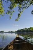 Canoe on Lake Shoreline Royalty Free Stock Photos