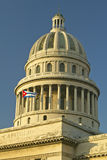 Morning light on the Capitolio and Cuban Flag, the Cuban capitol building and dome in Havana, Cuba Stock Photography