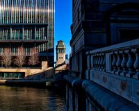 Morning light casts shadows of architecture on a Chicago River bridgehouse in the downtown Loop stock photography