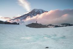 Morning light high above the cloud layer on Mount Rainier. Beautiful Paradise area, Washington state, USA. stock photo