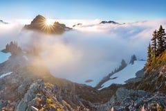 Morning light high above the cloud layer on Mount Rainier. Beautiful Paradise area, Washington state, USA. royalty free stock photo