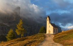 Morning light illuminated church Stock Photos