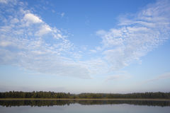 Morning light at the lake. Reflecting water. Stock Photos
