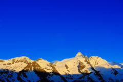 Morning light mountains with blue sky without clouds. Mountains in the Alps. Mountain scenery in winter. Grossglockner ountain in Royalty Free Stock Photo