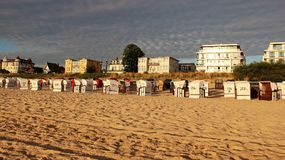 Empty Beach And Colorful Sky With Morning Light By Seaside. Morning light and multicolored sky. with topical local beach chair on baltic seaside in usedom island Royalty Free Stock Image
