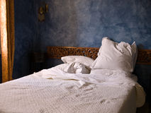 Morning light onto bed Royalty Free Stock Image