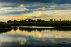 Morning light reflecting in lake Stock Photo